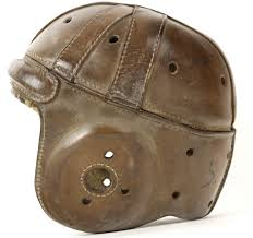 new playing field vs old playing field leather football helmet