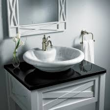 round vessel sinks in white and dark tones