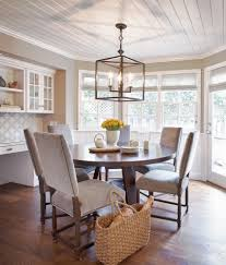 contemporary dining room design with black iron candle lantern farmhouse light fixtures 6 seater light