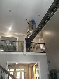 hanging chandelier in 2 story foyer