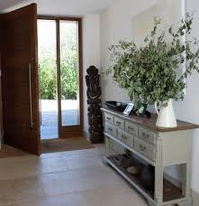 modern entry furniture. entryway decorating with light furniture and green plants modern entry