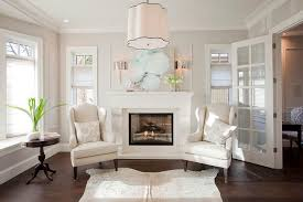 fireplace with wingback chairs