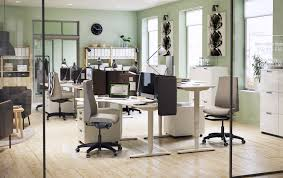 ikea home office furniture. the bekant sit/stand desk in a modern office environment. ikea home furniture