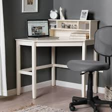 small corner white desk with small hutch and gray rolling chair