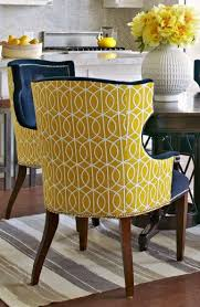 chairs upholstered in two diffe fabrics can have real pop