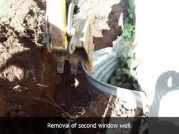 window well drainage. Classic Drainage, Inc. Window Well Drainage Installation
