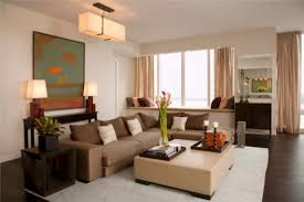 room harmonious small space apartment living room design ideas with goodly brown sectional sofa and cream upholstery leather large square coffee table above apt furniture small space living