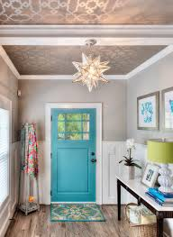 ... Metallic wallpaper on the ceiling and a splash of blue aim to bring  Mediterranean charm to
