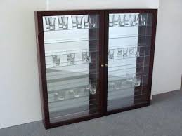awesome shot glass cabinet shot glass display cases a shot glass cabinet wood shot glass display