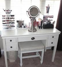 vanity table. White Wooden Makeup Storage With Toe Drawers On The Side And Small Round Mirror Vanity Table