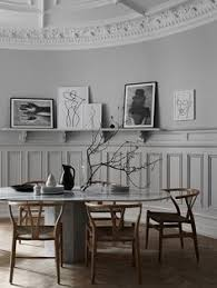 beautiful dining room design with gallery wall art and wishbone chairs