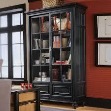 black bookshelves with glass doors