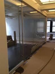 clear glass frameless wall door