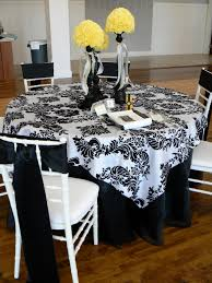 patterned black and white table cloth for round table feat yellow flower centerpiece idea