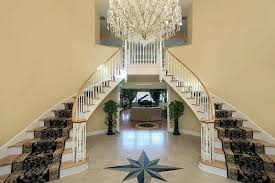 foyer with double stairs and star floor design