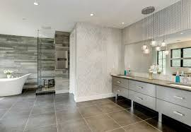 contemporary bathroom with globe pendant lights and tub