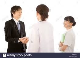 What Is A Pharmaceutical Sales Rep Female Doctor And Pharmaceutical Sales Representative Shaking Hands