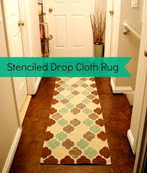 how to make a stenciled drop cloth rug from lovely crafty home featured at diy saay at a cultivated nest