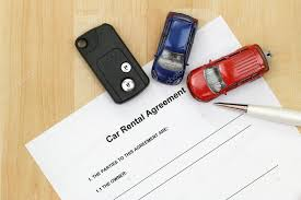 Car Rental Agreement, Remote Car Key, A Pen And Mini Car Models ...