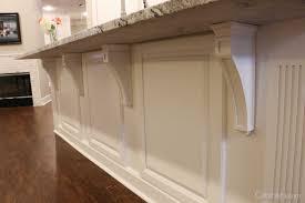 decorative corbels add elegant del to a white kitchen island