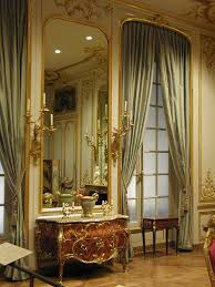 Commode of the Rococo period! Gilded wall paneling, softer green ...