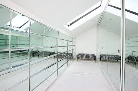 dressing room ideas closet contemporary with mirrored closet doors sloped ceiling architecture ideas mirrored closet doors