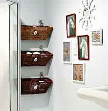 Small Framed Bathroom Wall Art Near Three Hanging Rattan Boxes Under Small  Mirror