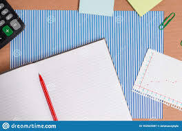 Cardboard Desk With A Striped Blue Sheet Notebook Paper And