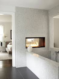 dual fireplace in a marble tiled bathroom decoist micoley s picks for luxuriousbathrooms