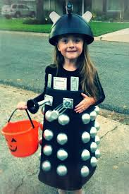 diy dalek costume was made from a black rectangular trash can i cut the bottom out and turned upside down cut ball pit in half and spray
