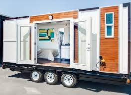 Small Picture Man Converts Shipping Container into Tiny Home on Wheels Sea