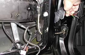 installing electric life power windows in a vw golf the rubber boot in the door jamb is pulled loose from the plastic block the outer nut locking ring is twisted to the left and the wiring connector block