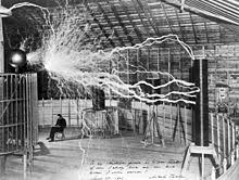alternating current tesla. a multiple exposure picture of tesla sitting next to his \ alternating current