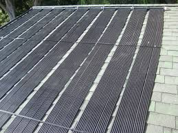 solar heat collector panels on a roof for a diy installation of a commercial solar pool