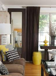 if you re worried that your brown living room is too dark try using yellow as an accent color just a few pieces of yellow decor can add tons of brightness