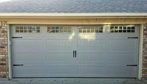 double garage door and single aluminium sectional overhead doors with window panels charcoal horizontal slats screen