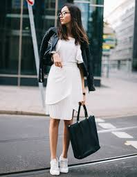leather jacket with white dress and sneakers