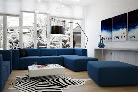 modern blue living room design luxury sectional sofa and ottoman white low coffee table zebra pattern area rug brick wall decoration and art picture pendant