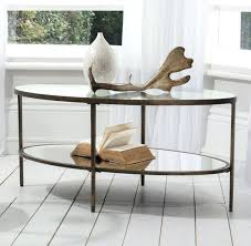 x h a3 an exquisite oval metal framed coffee table featuring aged bronze finish with inlaid tempered