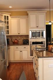 distressed antique white cabinets. more like what white cupboard would look in our yellow kitchen distressed antique cabinets