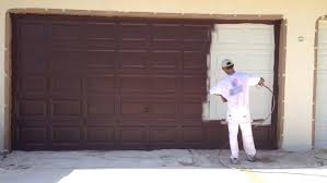 paint a garage door painting a metal garage door and preparing metal garage doors for painting doctor paint garage door brush or roller