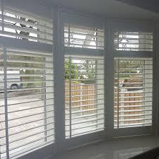 Great Contoured Wooden Venetian Blinds Pk Within Vertical Bay Bay Window Vertical Blinds