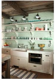 green tile kitchen backsplash sea glass green subway tile and open shelves  so pretty sea glass