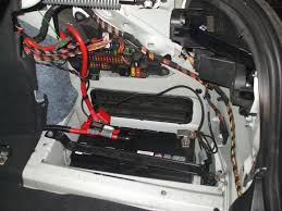 bmw 5 series where is the battery and fuse box located auto to remove the panel you must use caution and lift the carpet up to be able to slide it out