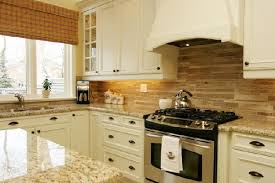 should you continue the granite onto the backsplash it s busy as well there s enough going on with what s just sitting on the countertops
