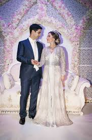 moroccan wedding dress. Couples Photos Groom in Navy Suit Bride in Embellished Ensemble