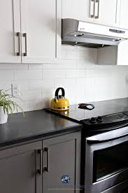 budget friendly kitchen with painted cabinets benjamin moore chelsea gray white subway tile and black nowadays laminate countertops