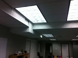 lighting in an office. overhead fluorescent lights in an office lighting