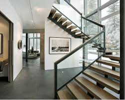 Modern wooden open and glass railing staircase idea in Denver