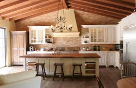 Spanish style kitchen with tile backsplash and floors with breakfast bar